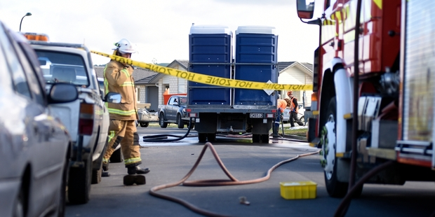 SMELLY SPILL: Fire crews responded to a human waste spill on Batty St in Papamoa.PHOTO/GEORGE NOVAK
