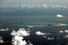 Seen from a military plane, China's alleged ongoing reclamation of Mischief Reef in the Spratly Islands in the South China Sea. Photo / AP