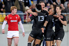 Israel Dagg celebrates with teammates after scoring the opening try in the second test between the All Blacks and Wales. Photo / Getty