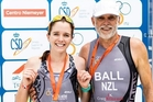 Father and daughter Max and Morgan Ball at the finish of the World Duathlon Championships in Spain.