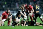 Brad Weber kicks forward during  the Chiefs clash with Wales last night. Photo / Getty Images