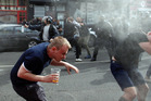English fans run after getting sprayed with pepper spray by French police during scuffles in downtown Lille. photo / AP