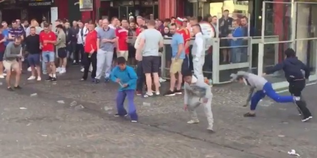 Loading A group of English fans in France have been caught taunting begging children in the street. Photo: Watch Sport!/YouTube