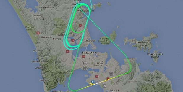 The flight was put into a holding pattern, circling over Albany and Whangaparaoa, to burn off fuel. Photo / flightradar.com