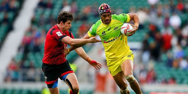 Pama Fou of Australia avoids a tackle from Owen Jenkins of Wales during day two of the HSBC London Sevens at Twickenham Stadium on May 22, 2016. Photo / Getty