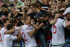 Hungarian players celebrate with fans after Hungary's Adam Szalai scored. Photo / AP
