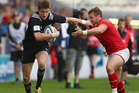Jordie Barrett of New Zealand holds Billy McBryde of Wales. Photo / Getty