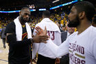 LeBron James celebrates with teammate Kyrie Irving after defeating the Golden State Warriors in Game 5 of the 2016 NBA Finals. Photo / Getty Images