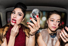 Women who wear makeup appear more dominant when judged by other women. Photo / Getty