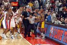Ben Wallace and Ron Artest are separated before the fight spilled into the crowd. Photo / Getty Images