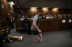 Oscar Pistorius removed his prosthetic limbs and hobbled around the courtroom. Photo / Getty Images