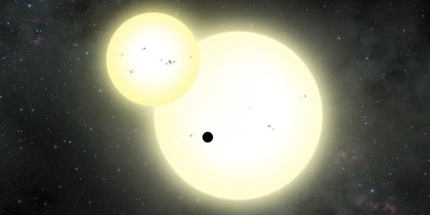 An artist's impression of the simultaneous stellar eclipse and planetary transit events on Kepler-1647 b. Such a double eclipse event is known as a syzygy. Picture / Lynette Cook.