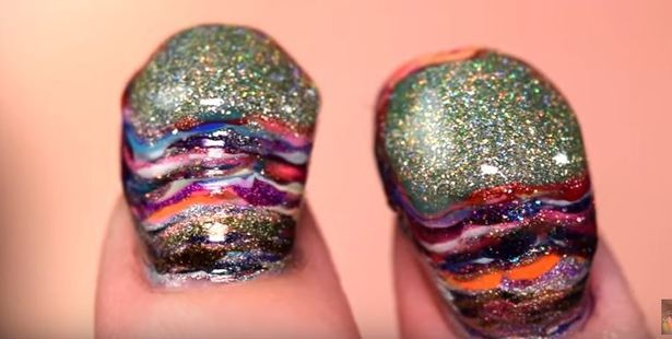 The gruesome result - 116 coats of polish later. Photo / YouTube / Simply Nailogical