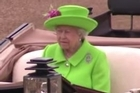 Queen Elizabeth II marked her official 90th birthday by taking the salute at a special military parade in London where her vivid green outfit caused a sensation.