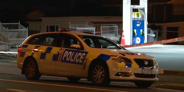 A police car outside the Mobil Forbury station. Photo / Supplied