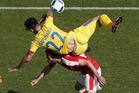 Romania's Cristian Sapunaru, top, falls over Switzerland's Admir Mehmedi. Photo / AP