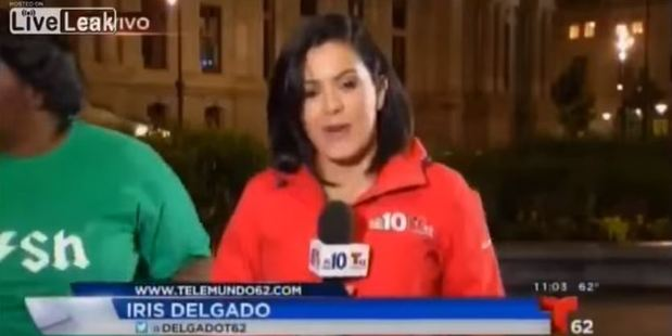 Iris Delgado was wrapping up a report outside City Hall. Photo / via YouTube