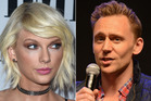 Taylor Swift has her eyes and camera locked on Tom Hiddleston. Photos / Getty Images