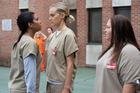 Maria (Jessica Pimentel), left, confronts Piper (Taylor Schilling) in Season 4 of Orange Is the New Black. Photo / Netflix
