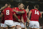 Welsh Number 8 Taulupe Faletau celebrates with his team after scoring the first try against the All Blacks. Photo / Nick Reed