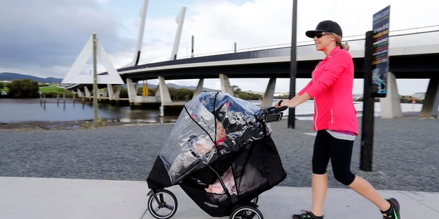 UNUSUALLY WARM: Whangarei mother Monique Cross was among those who took advantage of the warmer than usual winter by taking to the Hatea Loop walkway. PHOTO/JOHN STONE