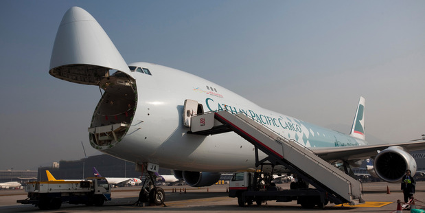 A Cathay Pacific Airways Boeing 747-8 freighter with the nose cargo door opened. Photo / Bloomberg