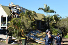 Extensive storm damage to houses is seen in Mooloolaba on the Sunshine Coast. Photo / AAP