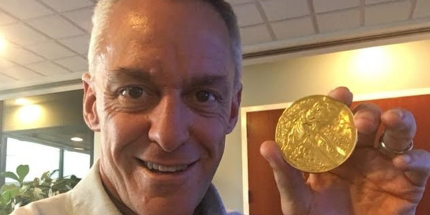 Joe Jacobi and his medal. Photo: Joe Jacobi / Washington Post