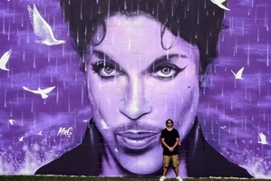 Graham Hoete spent about three days painting the Prince mural on a Chanhassen, Minnesota wall.