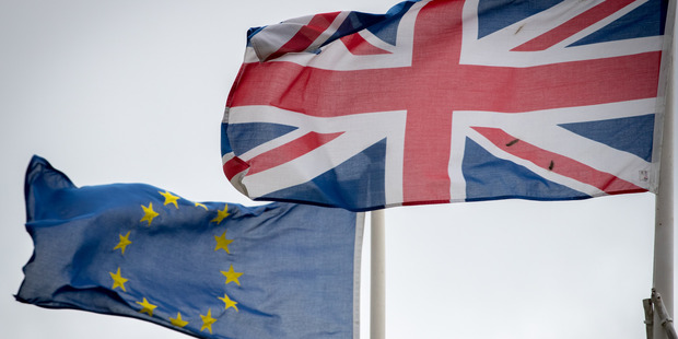 The Union Jack flag flies besides the flag of the European Union. Photo / Getty Images