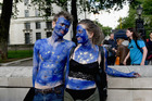 A young couple painted as EU flags protest on outside Downing Street against the United Kingdom's decision to leave the EU. Photo / Getty Images