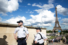 French police officers patrol at Trocadero Plaza next to the Eiffel Tower in Paris. Photo / AP