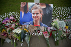 An image and floral tributes for Jo Cox, lay on Parliament Square, outside the House of Parliament in London. Photo / AP
