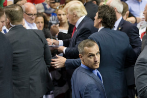 In this April photo, Republican presidential candidate Donald Trump's campaign manager Corey Lewandowski walks a rope line as the candidate signs autographs. Photo / AP