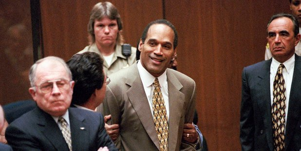 OJ Simpson celebrates after being found not guilty at his 1995 murder trial. Photo/AP