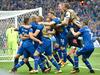Iceland players celebrate their last minute winner against Austria. Photo / AP