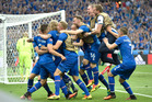 Iceland players celebrate their last minute winner against Austria. Photo / AP