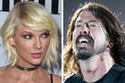 Taylor Swift saved Foo Fighters frontman, Dave Grohl from embarrassing himself in front of Paul McCartney. Photo / Getty Images, NZH
