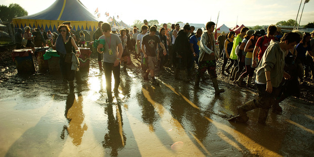 Glastonbury's muddy grounds made it difficult to get help to a man on fire. Photo / Getty Images