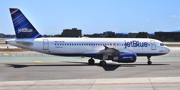 Jet Blue airline is offering free flights to family members of victims killed or injured in the Orlando nightclub attack. Photo / Getty Images