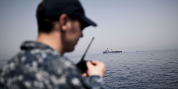 A US Navy sailor takes part in multinational training exercises aboard the USS Ponce vessell. Photo / Getty Images