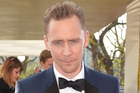 Tom Hiddlestone couldn't believe his butt was cut out of a scene in the Night Manager. Photo / Getty Images