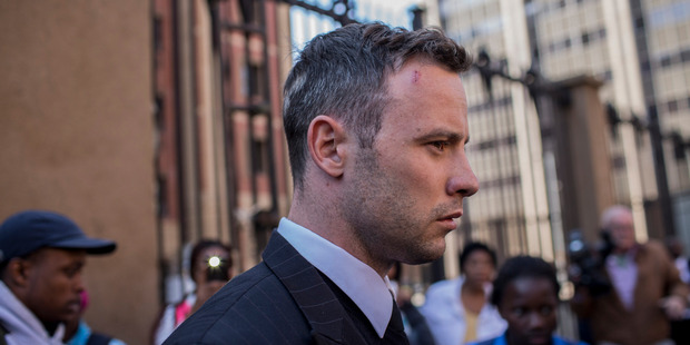 Oscar Pistorius leaves the North Gauteng High Court for lunch after removing his removing prosthetic legs earlier. Photo / Getty