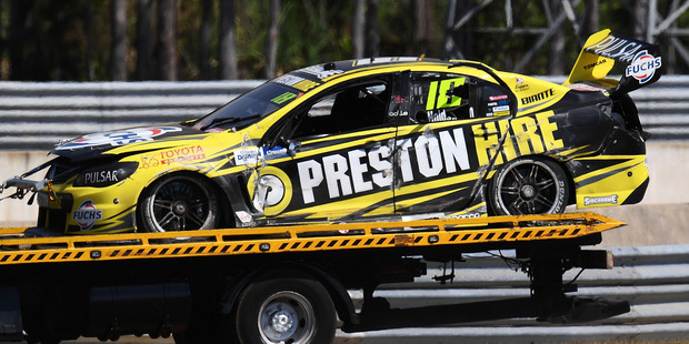 The car of Lee Holdsworth is towed off the track after crashing. Photo / Getty Images