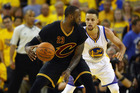 LeBron James handles the ball against Stephen Curry in Game 7. Photo / Getty Images