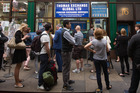 Customers queue outside a foreign currency exchange bureau in London. Photo / Bloomberg
