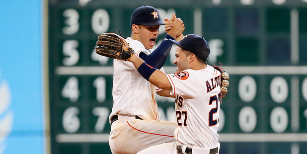 Jose Altuve and Carlos Correa celebrate Houston's 3-2 win over the Los Angeles Angels. Photo / Getty Images