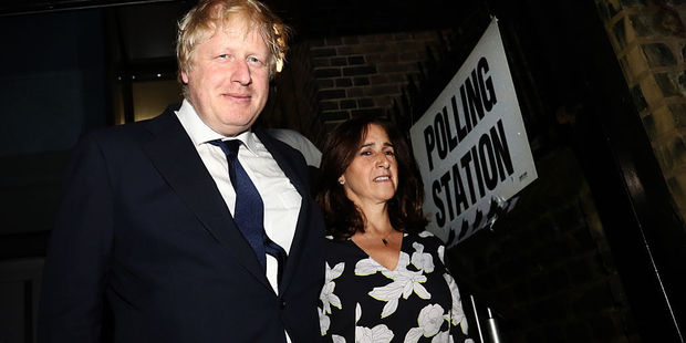 Loading Boris Johnson and suffering wife return from the polling station. Photo / Getty