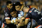 Ben Barba of the Sharks is tackled by the Warriors defence. Photo / Getty