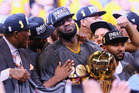 LeBron James #23 of the Cleveland Cavaliers holds the Larry O'Brien Championship Trophy after defeating the Golden State Warriors. Photo / Getty Images.
